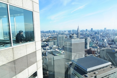 administrative buildings: Tokyo, Japan - 28 December, 2011: Tourists admiring the Japanese capital city from the Metropolitan Governmental Building in Shinjuku, Tokyo