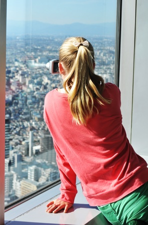 governmental: Tokyo, Japan - 28 December, 2011: Tourist admiring the Japanese capital city from the Metropolitan Governmental Building in Shinjuku, Tokyo Editorial