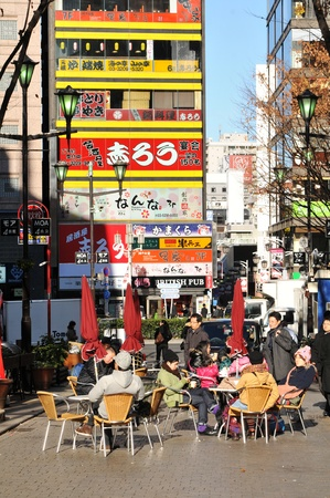 Tokyo, Japan - 27 Dec, 2011: People relaxing at restaurant terrace in Shinjuku, major commercial and administrative district of Tokyo Stock Photo - 12571262