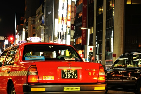 Tokyo, Japan - 28 December, 2011: Close up of red taxi car in Ginza shopping district at night Stock Photo - 12571183