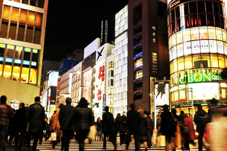 Tokyo, Japan - 28 December, 2011: Pedestrians crossing the street in Ginza shopping district