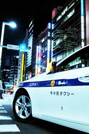 Tokyo, Japan - 28 December, 2011: Close up of taxi car in Ginza at night