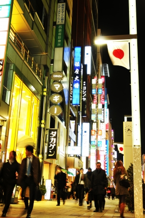 Tokyo, Japan - 28 December, 2011: Night view of people shopping in the luxurious district of Ginza, Tokyo
