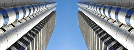panoramic business: Tokyo, Japan - 28 Dec, 2011: Architectural detail of symmetrical corporate buildings in Shinjuku, Tokyo