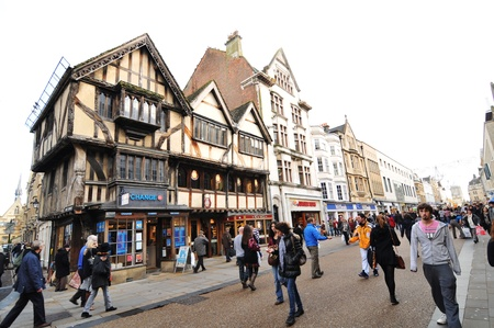 Oxford, England � November 12, 2011: Pedestrians and old architecture in central Oxford, England