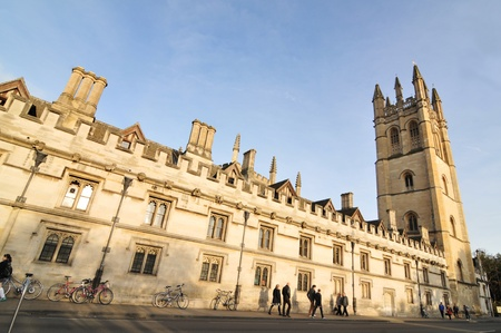Oxford, England – November 12, 2011: Pedestrians and old architecture in central Oxford, England