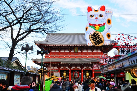 asakusa: Tokyo, Japan - 30 December, 2011: Tourists visiting Sensoji Temple, a Buddhist temple located in Asakusa. It is one of Tokyos most colorful and popular temples.
