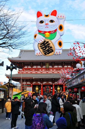 Tokyo, Japan - 30 December, 2011: Tourists visiting Sensoji Temple, a Buddhist temple located in Asakusa. It is one of Tokyos most colorful and popular temples.