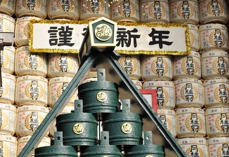 Tokyo, Japan - 31 December, 2011: Detail of traditional sake barrels at Japanese Shinto shrine. Barrels of sake are broken open (Kagami biraki) during Shinto ceremonies. Sake (called iwai-zake, literally celebration sake) is served freely to all to spread Editorial