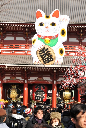 believed: Tokyo, Japan - 31 December, 2011: Detail of Lucky Cat (Maneki Neko) at Sensoji Temple in Asakusa, Tokyo. It is a common Japanese sculpture which is believed to bring good luck to the owner.