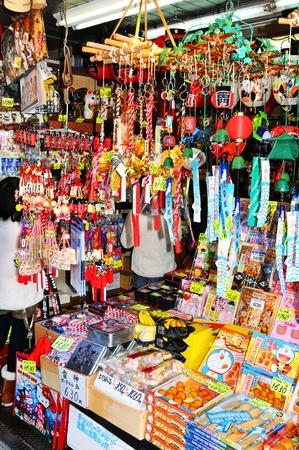 Tokyo, Japan - 31 December, 2011: Religious objects displayed in bazaar at Sensoji temple market in Asakusa, Tokyo Stock Photo - 13062313