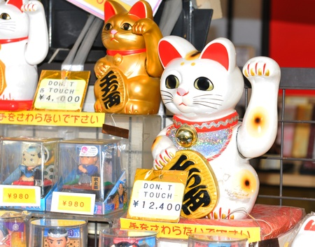 Tokyo, Japan - 31 December, 2011: Detail of Lucky Cat (Maneki Neko) at Sensoji Temple in Asakusa, Tokyo. It is a common Japanese sculpture which is believed to bring good luck to the owner. Stock Photo - 13062047