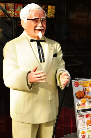 colonel: Tokyo, Japan - 2 January, 2012: Statue of Colonel Harland Sanders, the founder of the KFC (Kentucky Fried Chicken) fast food chain, in Shibuya district, Tokyo