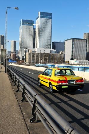 Tokyo, Japan - 2 January, 2012: Traffic on modern bridge in central Tokyo Stock Photo - 13022362