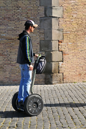 means of transport: Rome, Italy - 28 March, 2012: Tourist sightseeing with Segway ecological means of transportation on the streets of Rome