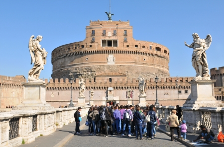 Rome, Italy - 28 March, 2012: Group of tourists visiting vestiges of Roman empire in the historical centre of Rome