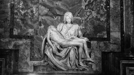 Rome, Italy - 28 March, 2012: The famous La Pieta sculpture by Michelangelo inside San Pietro (Saint Peter) basilica in Vatican