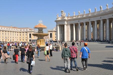 Rome, Italy - 28 March, 2012: Tourists visiting San Pietro (San Peter) square, major tourist landmark in Vatican, Rome Stock Photo - 13256728