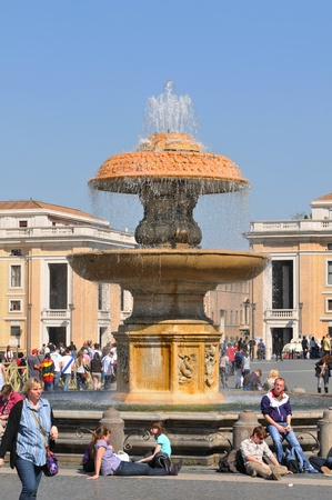 Rome, Italy - 28 March, 2012: Tourists visiting San Pietro (San Peter) square, major tourist landmark in Vatican, Rome