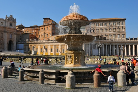 Rome, Italy - 28 March, 2012: Tourists sightseeing San Pietro (San Peter) square, major tourist landmark in Vatican, Rome