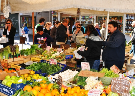 farmers market: Rome, Italy - 28 March, 2012: Fresh fruits and vegetables  for sale in Campo de Fiori, famous outdoor market in central Rome