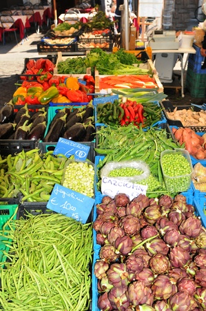 Rome, Italy - 28 March, 2012: Farmer selling organic products in Campo de Fiori, major outdoor market and landmark in Rome