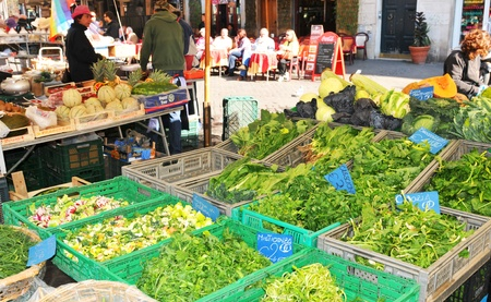 priced: Rome, Italy - 28 March, 2012: Fresh products for sale in Campo de Fiori, famous outdoor market in central Rome