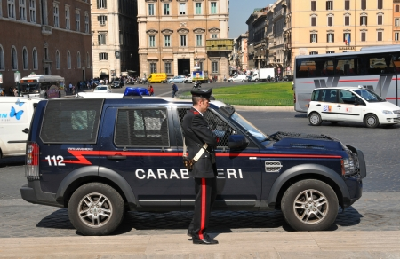patrolling: Rome, Italy - 29 March, 2012: Carabinieri, the national military police of Italy, guarding in Piazza Venezia