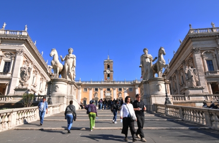 Rome, Italy - 30 March, 2012: Tourists visiting Piazza del Campidoglio, famous square in central Rome designed by Michelangelo