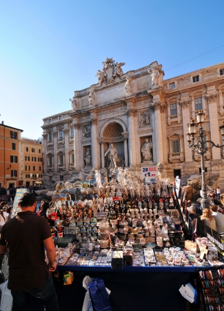 Rome, Italy - 30 March, 2012: Tourists souvenir shop in front of the Fontana di Trevi, one of the most famous fountains in the world. Stock Photo - 13795362