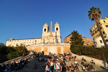 monti: Rome, Italy - 30 March, 2012: Tourists enjoying the sunset in Piazza di Spagna, Rome