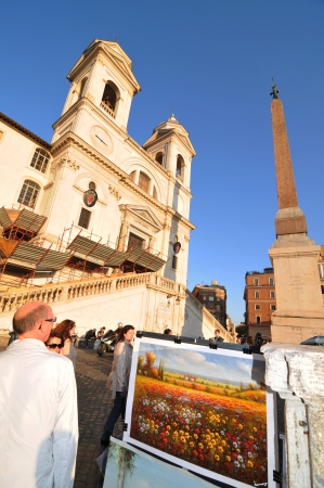 monti: Rome, Italy - 30 March, 2012: Tourists enjoying the sunset in front of the church of the Santissima Trinit?ei Monti Editorial