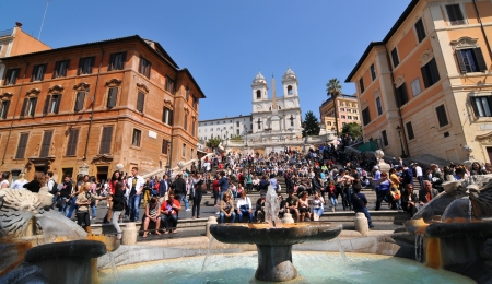 Rome, Italy - 30 March, 2012: Crowds of tourists enjoying the sun on The Spanish Steps (Scalinata della Trinit� dei Monti) in Piazza di Spagna, Rome
