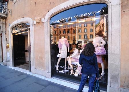 window shopper: Rome, Italy - 30 March, 2012: Woman shopping in Ermanno Scervino fashion store located Piazza di Spagna, Rome