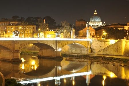 pietro: Rome, Italy - 29 March, 2012: Night view of bridge in Rome with San Pietro basilica in the background Editorial