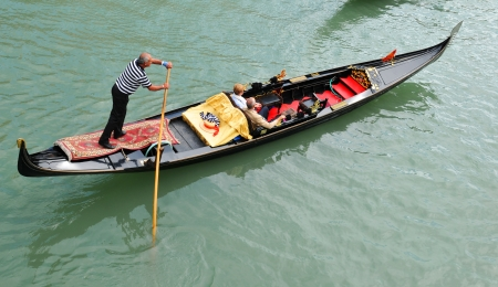 Venice, Italy - 06 May, 2012: Detail of gondolier by the Grand Canal in central Venice