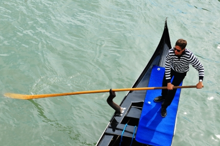 Venice, Italy - 06 May, 2012: Detail of gondolier by the Grand Canal in central Venice Stock Photo - 14145513