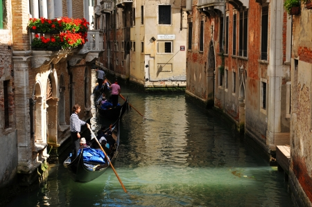 gliding: Venice, Italy - 06 May, 2012: Gondola gliding along the Grand Canal in central Venice