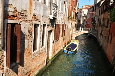 Venice, Italy - 6 May, 2012: Old architecture reflected in Venetian canal in Cannaregio