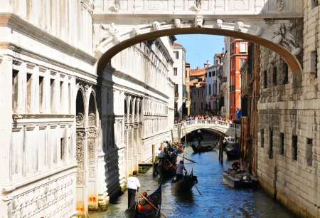 Venice, Italy - 6 May, 2012: View of the Ponte dei Sospiri (Bridge of Sighs), major landmark which passes over the Rio di Palazzo and connects the old prisons to the interrogation rooms in the Doges Palace.