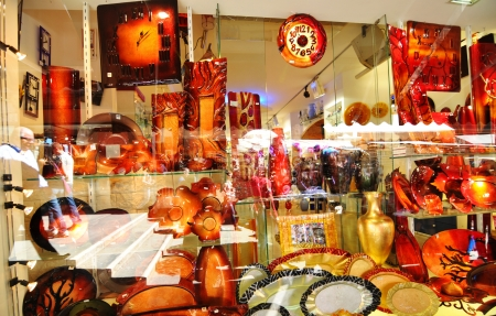 Venice, Italy - 6 May, 2012: Murano glass on display in window shop in Rialto market, Venice. Murano glass is a famous product of the Venetian island of Murano, traditional manufacturing centre.