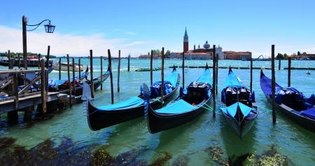 Venice, Italy - May 6, 2012: Detail of gondolas overlooking the Venetian island of San Giorgio Magiore (Venice, Italy)