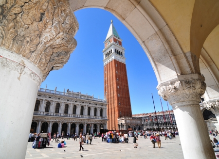 saint marco: Venice, Italy - 7 May, 2012: Tourists visiting Campanile bell tower in San Marco Piazza (St. Mark