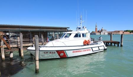 guard ship: Venice, Italy - 7 May, 2012: Italian coast guard boat anchored in Venetian lagoon