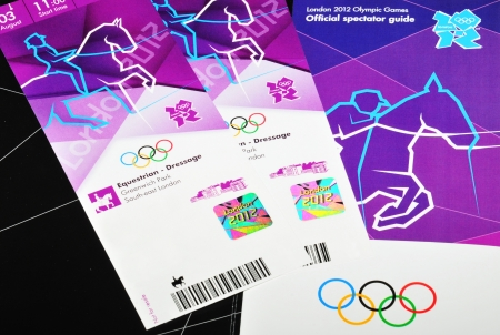 spectator: London, 14 June, 2012: Tickets for the London 2012 Olympic Games are distributed to purchasers. London 2012 Olympic kit also contains the Official spectator guide and travel cards. Editorial