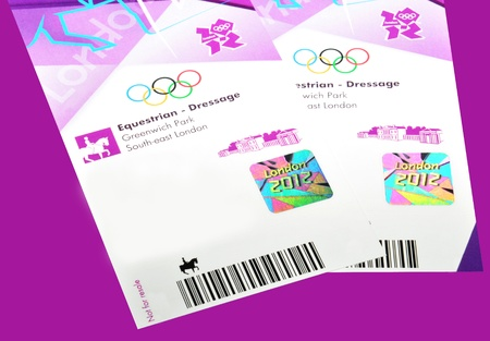 resale: London, 14 June, 2012: Tickets for the London 2012 Olympic Games are distributed to purchasers. London 2012 Olympic kit also contains the Official spectator guide and travel cards. Editorial