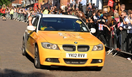 Nottingham, UK - 28 June, 2012: London 2012 Olympic Torch Relay official car precedes the convoy through the Nottingham city centre
