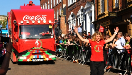 convoy: Nottingham, UK - 28 June, 2012: London 2012 Olympic Torch Relay Coca Cola official sponsors convoy salute the crowds through the Nottingham city centre