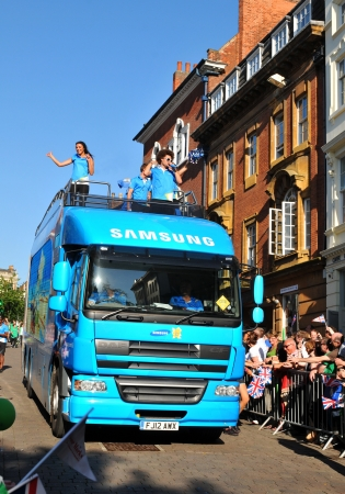 Nottingham, UK - 28 June, 2012: London 2012 Olympic Torch Relay Samsung official sponsors convoy salute the crowds through the Nottingham city centre