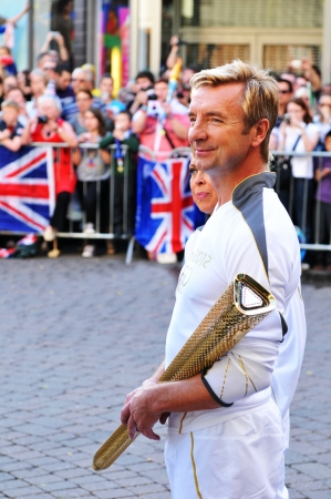 Nottingham, UK - 28 June, 2012: London 2012 Olympic torch bearers are ready to carry the flame through the city centre